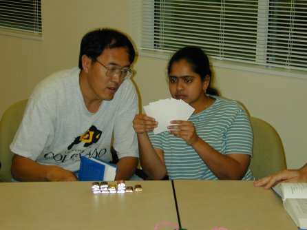 two people looking at their hand of cards