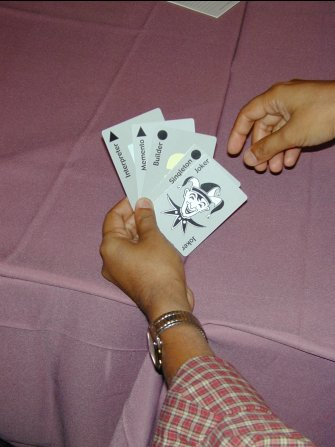 a hand of four cards with a joker on top