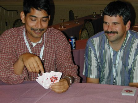 two people looking at a hand of cards