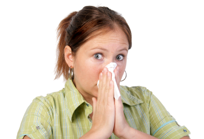 A person blowing their nose into a tissue